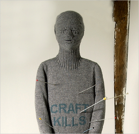 "A detail from Freddie Robins's ""Craft Kills,"" a comment on the post-9/11 ban on knitting needles in airplanes."