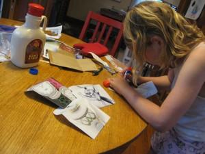 Bella creating magazine envelopes.